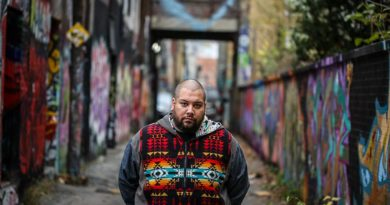 Portrait of DJ Shub in alleyway