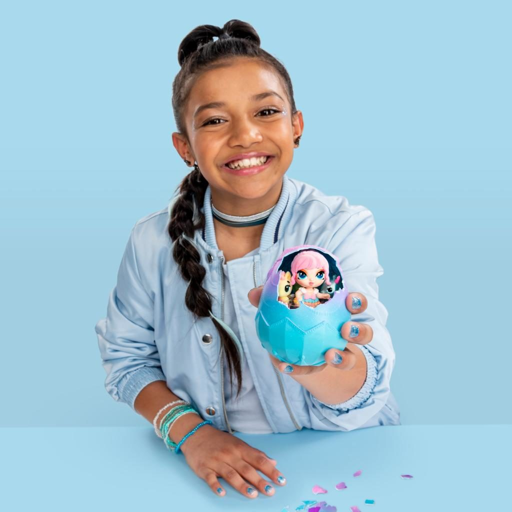 Photo of young teen girl with a Hatchimal Pixie in Egg