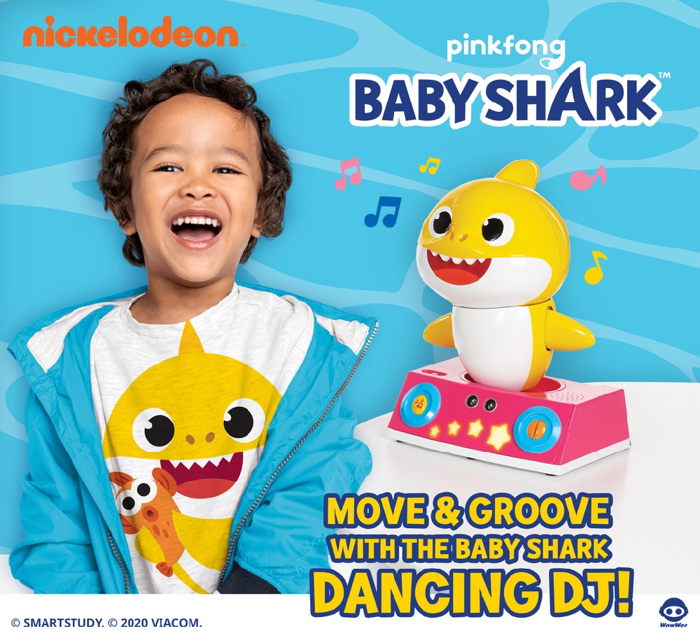 Happy child with WowWee Pinkfong Baby Shark Dancing DJ