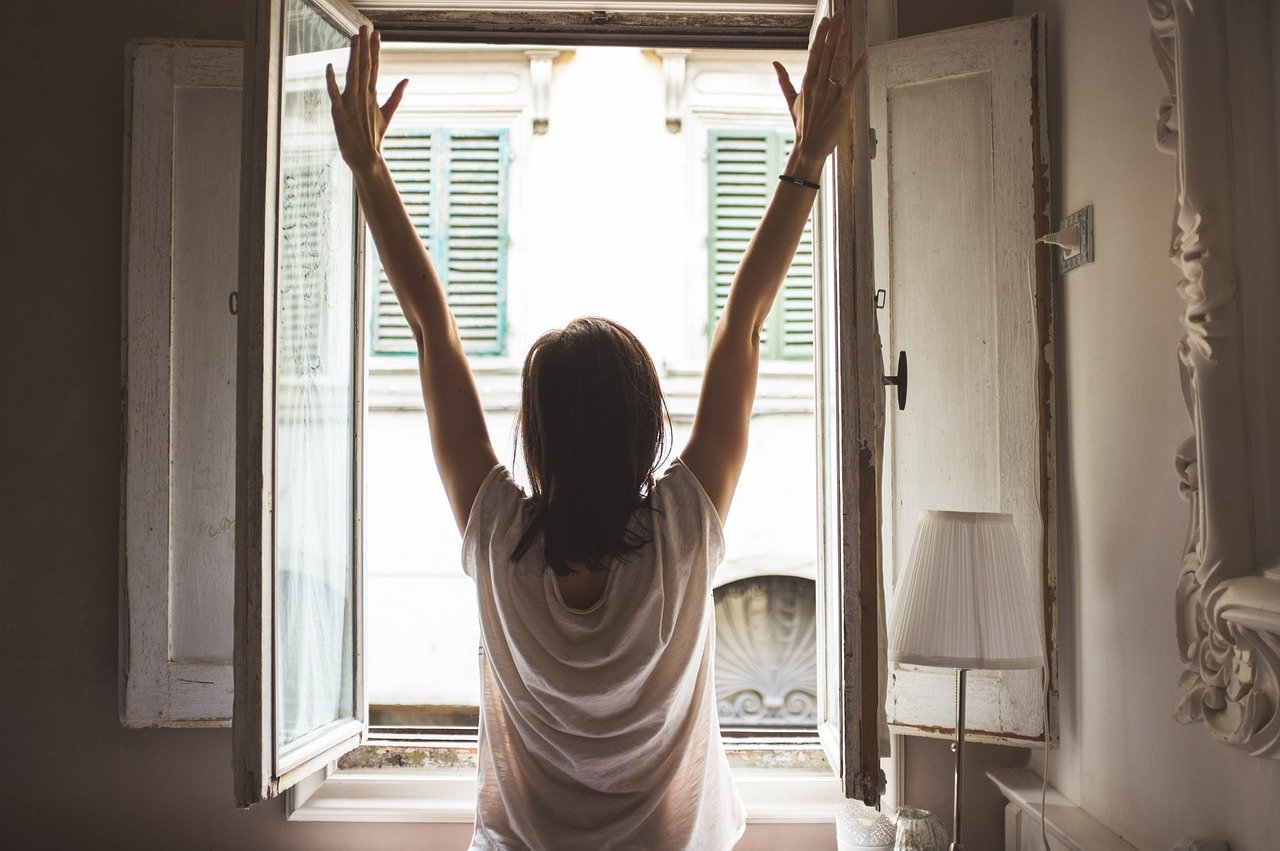 Photo of woman standing at window in the morning - Image by Free-Photos from Pixabay