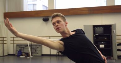 male dancer in the studio with right arm extended