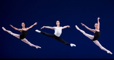 Benjamin Griffiths leaps across stage with Maria Chapman and Lesley Rausch