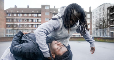 Lanre Malaolu being thrown to the ground in The Circle